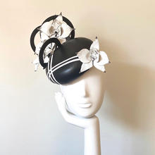 Black leather button with white leather orchids