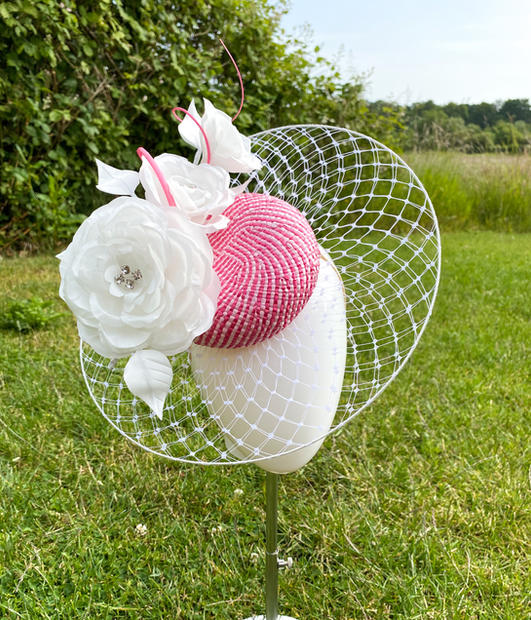 Pink and white rigid veil with white flowers