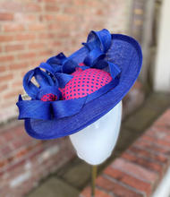 Cobalt blue sinamay saucer with bows and pink leather trim