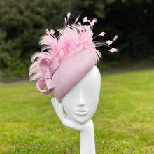 Lilac beret with feather trim