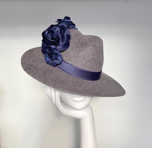 Grey fedora with midnight blue velvet flower