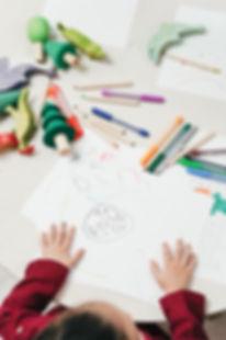 kid-on-white-table-painting-3662630.jpg
