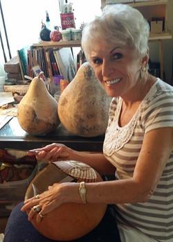 Geri working on a gourd.