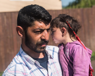 Romani dad with children in Transylvania