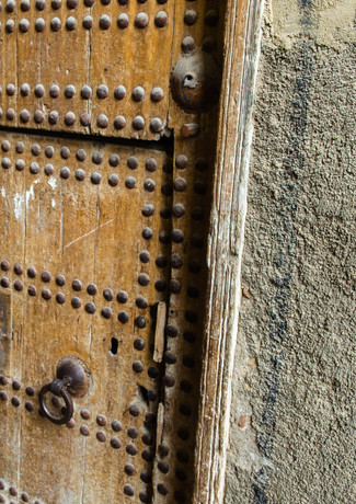 The small door is for women and children. For the men, they opened the whole door.