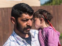 Dad with children in a romani village