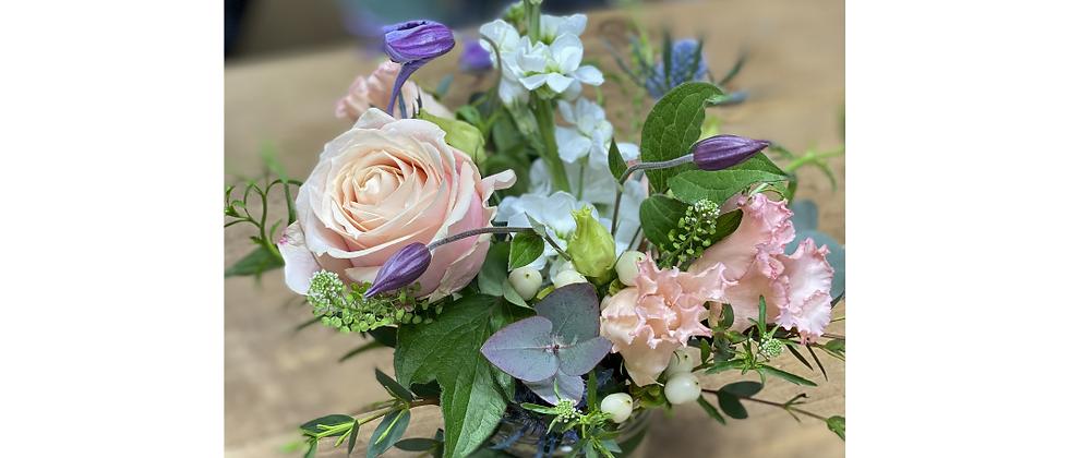 Posy jar of garden flowers