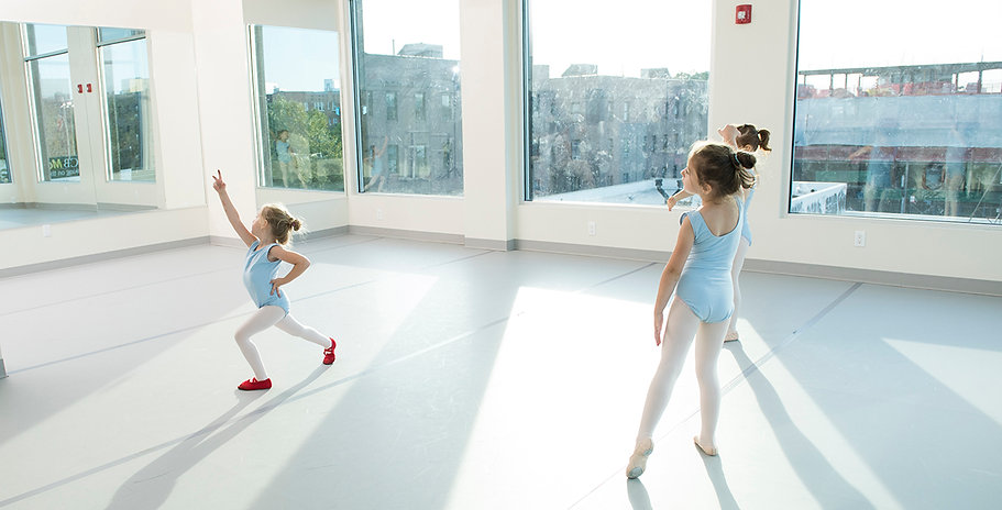 girls are dancing at ballet school.