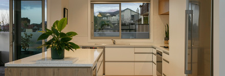 White Kitchen with Wood Features