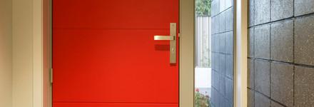Modern Brick Entryway with Feature Door