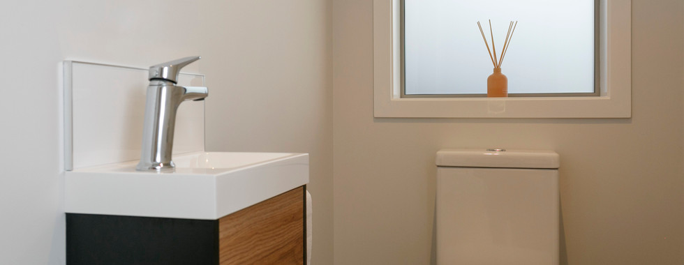 Guest Bathroom White with Wood Vanity