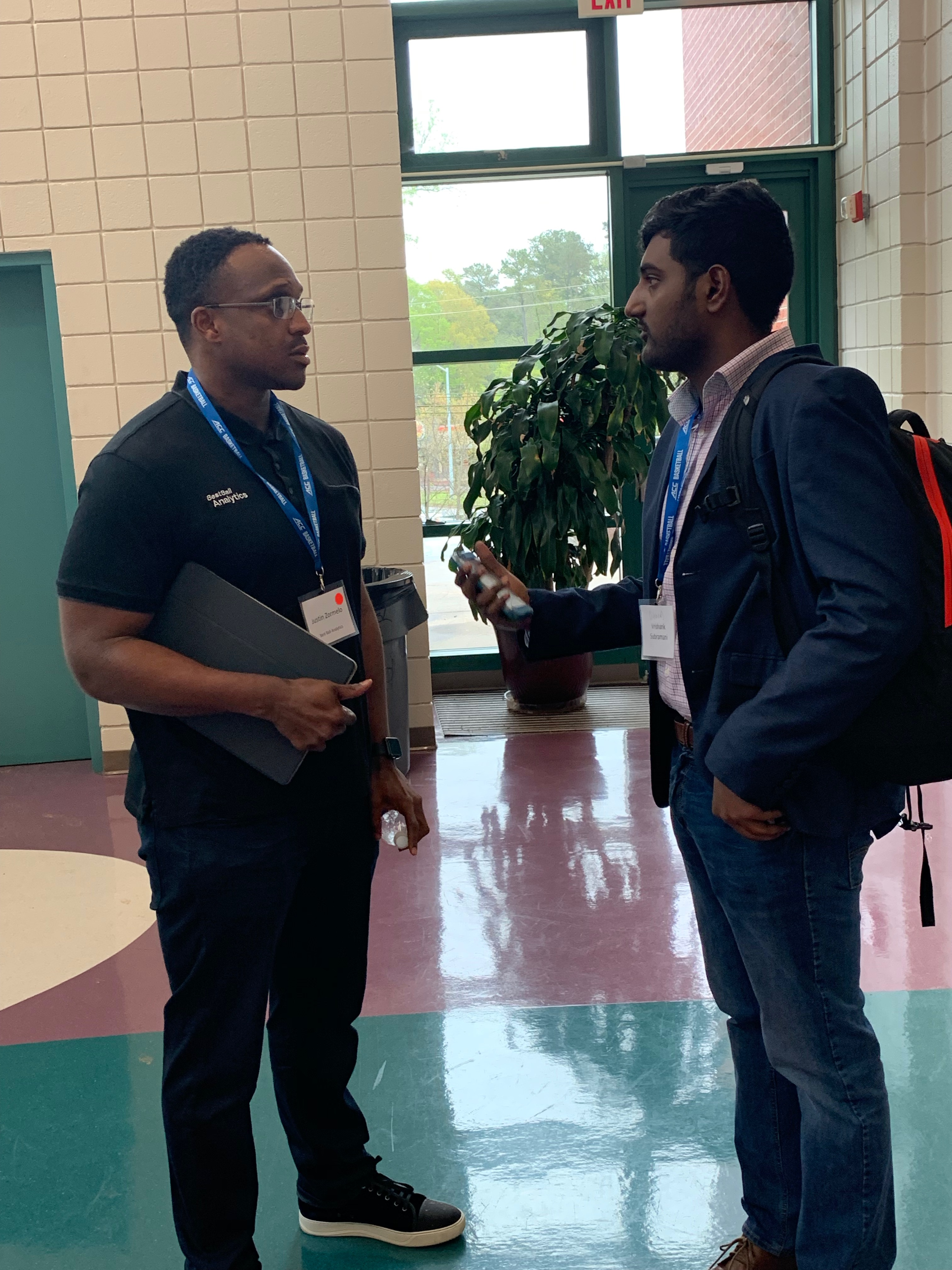 Justin Zormelo chats w/ an attendee