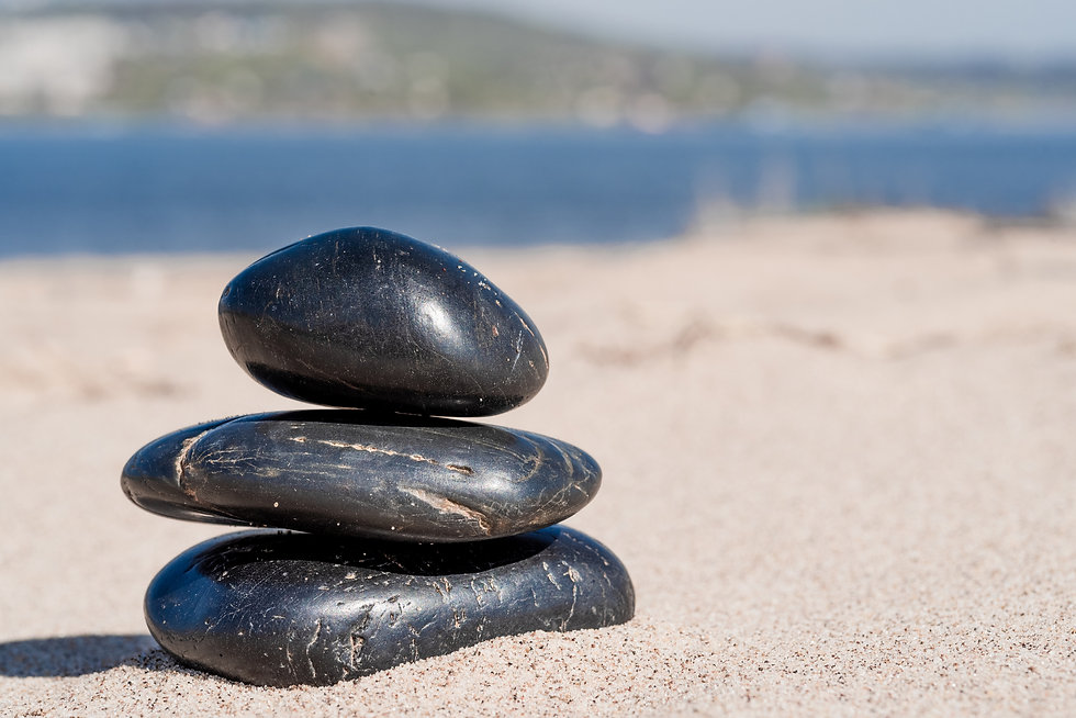 Zen-composition-of-pebbles-on-the-sea-sa