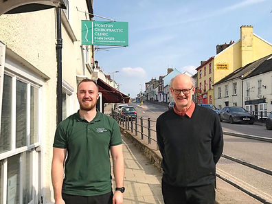 Austin Wells-Burr and Richard Stenning outside Honiton Chiropractic Clinic