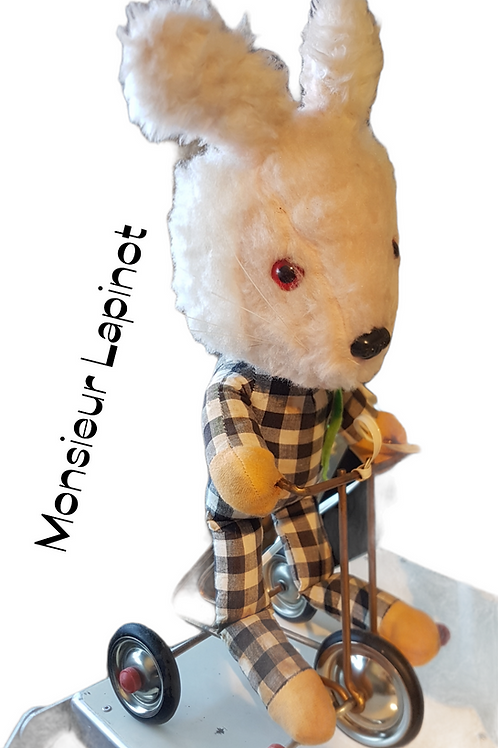 Jouet peluche tricycle lapin