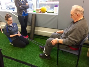 Pictured above: Sara helping John strengthen his hamstrings