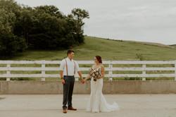 Bride-groom- holding hands- fence