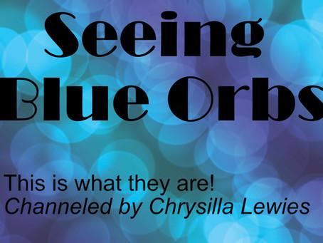 Seeing Blue Orbs of Light