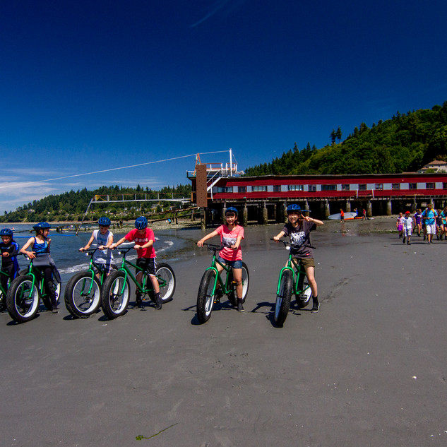 beachbikers and kids group on beach.jpg