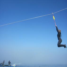 zipline girl against sky.JPG