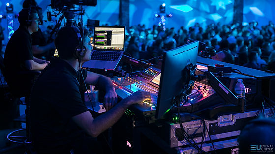 Audio and lighting consoles operation during corporate event