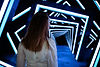 Girl stands in front of LED volume