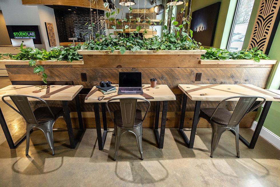 Three desks in open workspace