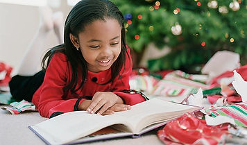 child reading at Christmas time.jpg
