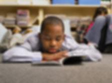 African American Boy reading.jpg
