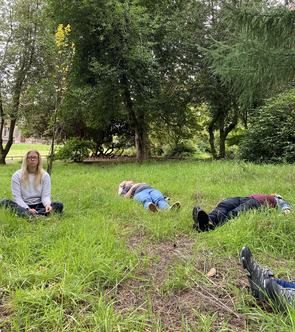 People lying in grass