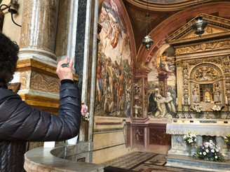 Capturing the head of St. Catherine in the mirror of my pilgram badge.