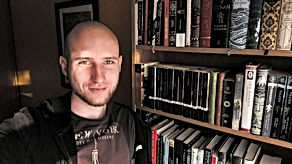 Authorpic2021withbookshelf.jpg