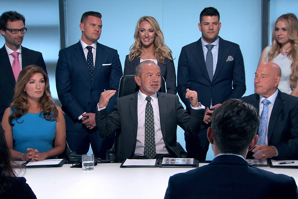 Previous winners of The Apprentice stood behind Lord Alan Sugar