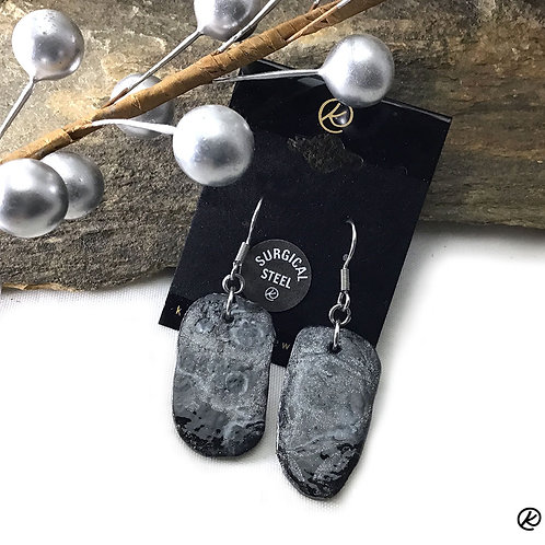 Unusual earrings in platinum and black poured acrylics