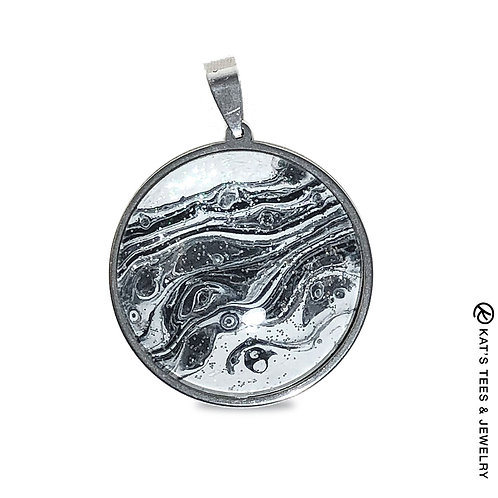 Black and white sparkly art in stainless steel pendant