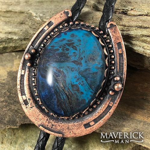 Copper horseshoe bolo with unusual stone