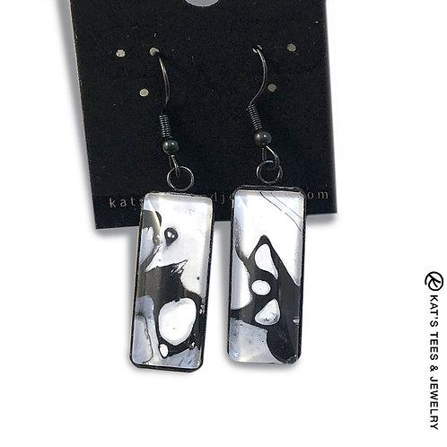 Artsy black and white earrings set in black stainless steel