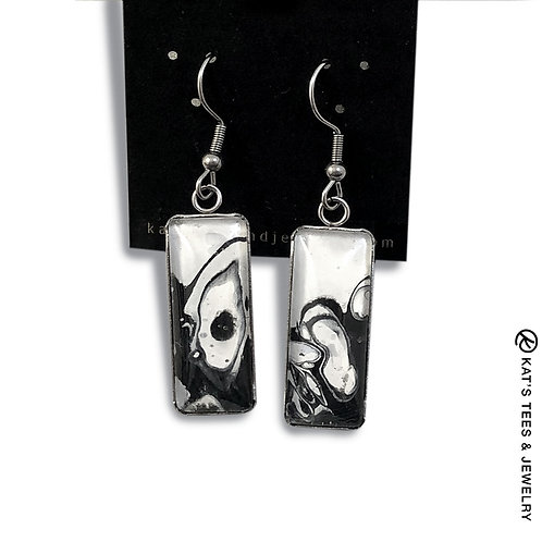 Contemporary black and white earrings set in stainless steel