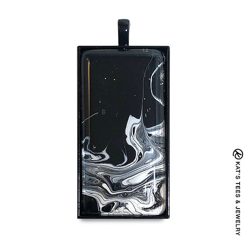 Hand painted black and white art in large black pendant