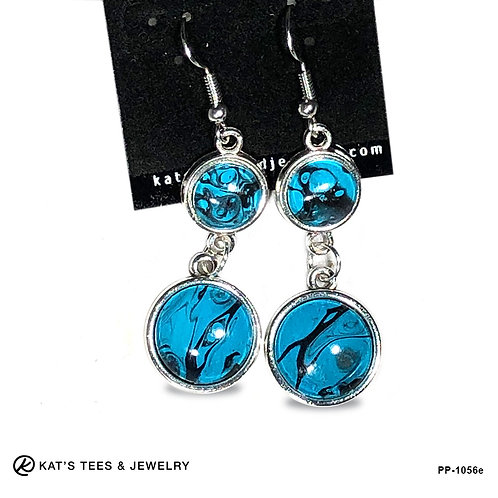 Dangly turquoise silver and black earrings from poured acrylics