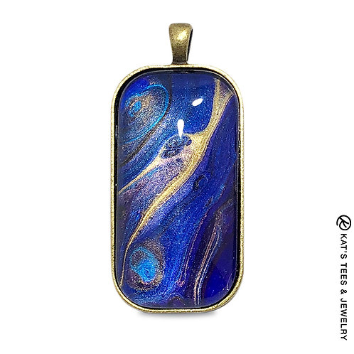 Beautiful metallic sapphire blue and gold poured acrylic pendant