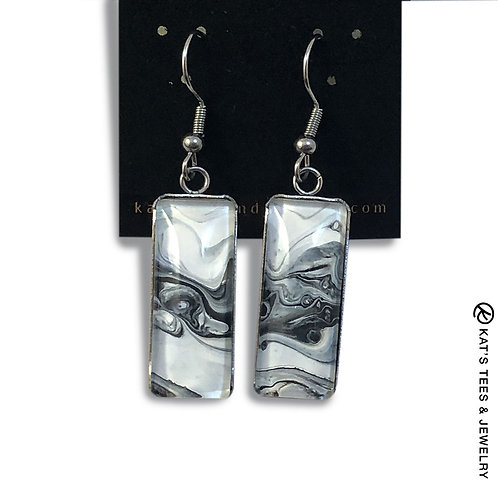 Artistic black and white earrings set in stainless steel