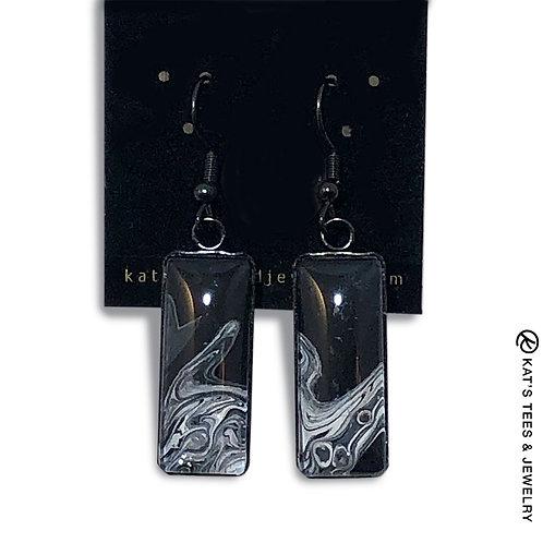 Black and white art in black stainless steel earrings