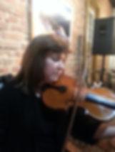Violinist performing at concert in Elizabethtown