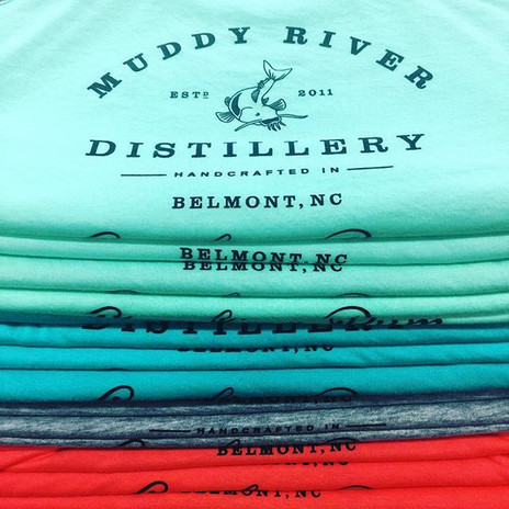 Lots of colorful shirts stacking up on t