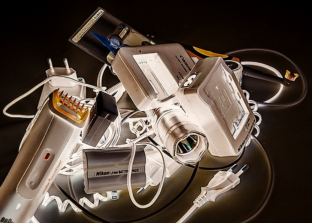 Tangle of cables, chargers and tools.