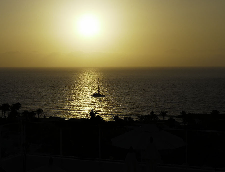 boat in sun reflection