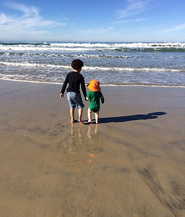 picture of two children getting ready to enter the ocean