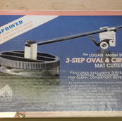 Logan model 201 3-step oval and circle mat cutter with original box and instructions.