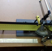 Logan mitre saw F100-2 with extension arm and spare saw blade.